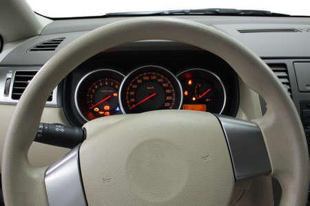 Closeup shot of steering wheel and dashboard photo