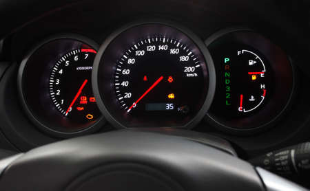 Car Dashboard closeup with glowing arrows Stock Photo - 4814265