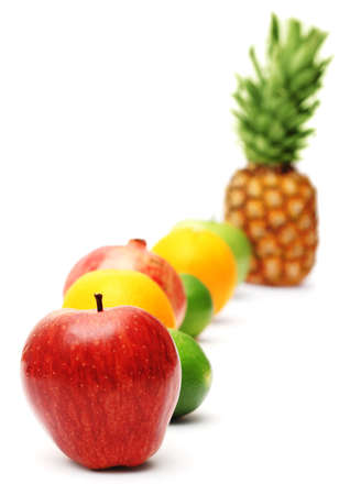 Row of bright fresh fruits isolated on white background photo