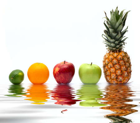 Row of fresh fruits reflected on water photo