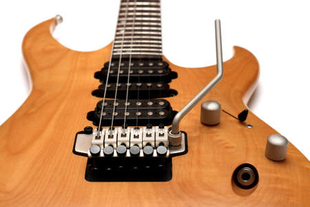 tremolo: Electric guitar body closeup isolated on white background