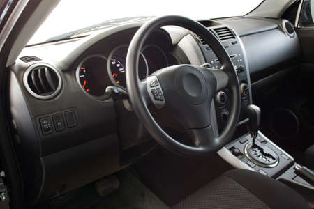 Car interior - dashboard and steering wheel photo