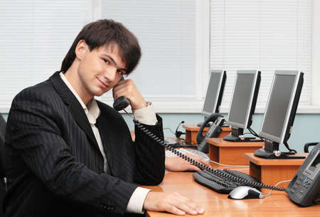 Young handsome businessman speaking by the phone Stock Photo - 4851302