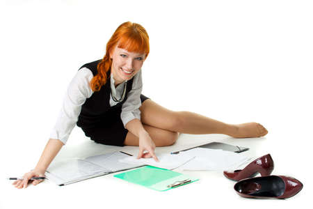 Cheerful businesswoman working with documents photo