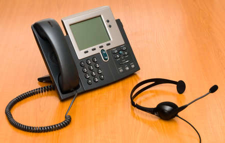 VoIP phone with a headset photo