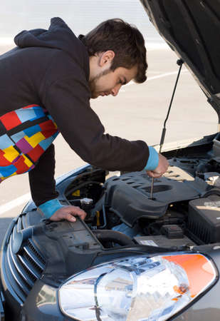Car driver examining the car's engine on a parking Stock Photo - 4833190