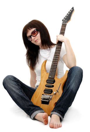 bare body women: Pretty young girl sitting and holding an electric guitar Stock Photo