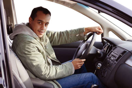 Young driver sitting in his new car photo