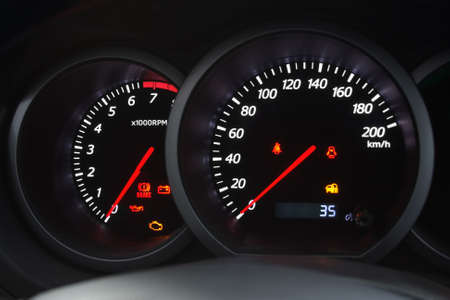 Closeup shot of a speedometer and tachometer of a modern car. photo