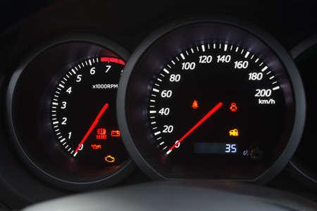 Closeup shot of a speedometer and tachometer of a modern car. photo