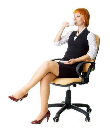 Attractive businesswoman having a coffee break Stock Photo - 4940500