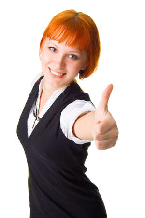 Young businesswoman showing thumbs up sign photo