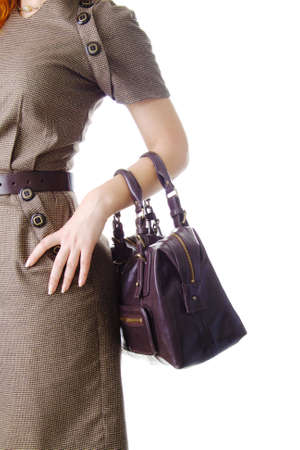 leather bag: Woman holding a bag, isolated on white