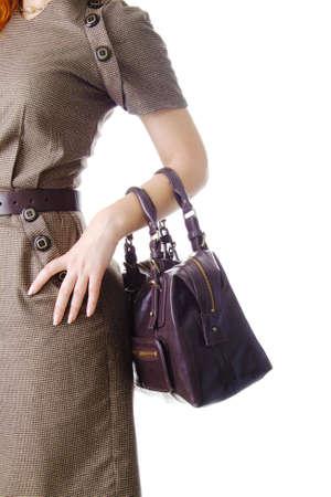 Mujer con una bolsa, aislado en blanco