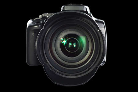 shutter: Professional digital camera on black background