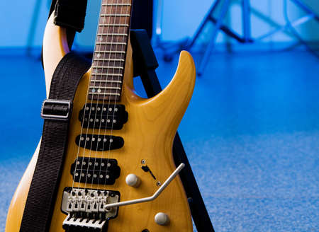 Electric guitar closeup isolated on white background photo