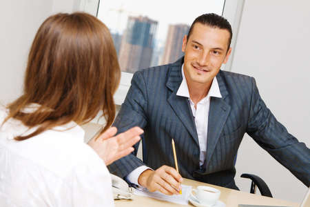 Professional advisor having a discussion with a customer photo