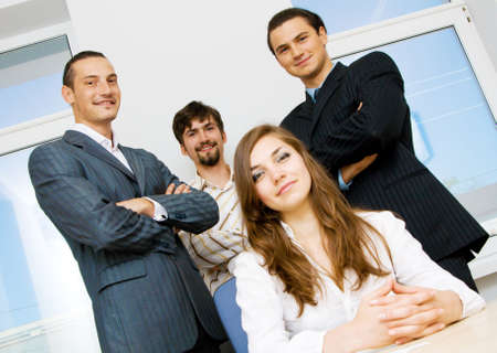 Successful business team, focus on men behind photo