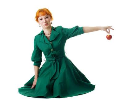 Beautiful lady holding an apple, white background photo