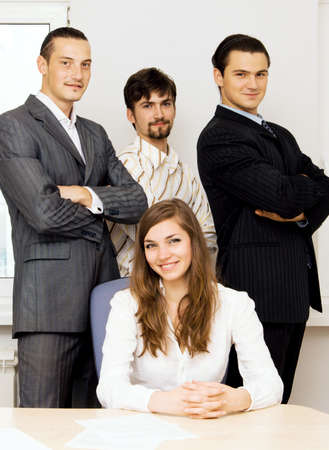 Successful business team, focus on men behind photo
