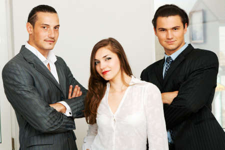 Successful business team of two men and one woman Stock Photo - 5253691