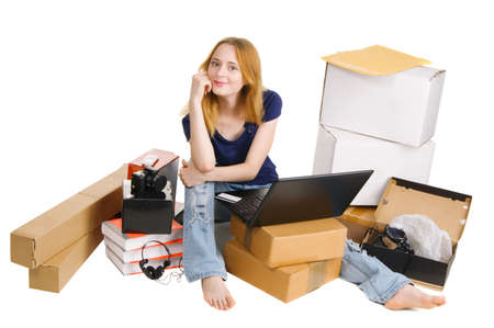 Young girl surrounded by her delivered online orders photo