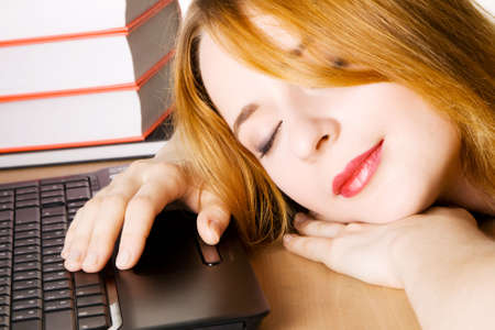 Young woman sleeping at her workplace photo