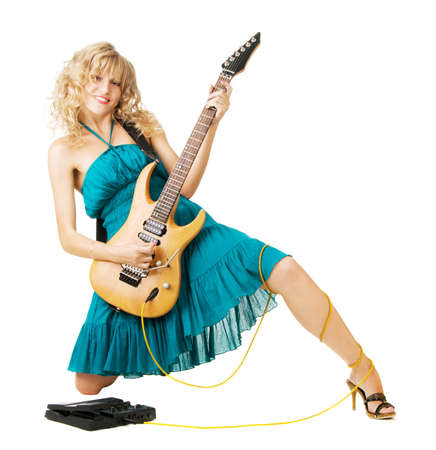Pretty young woman playing an electric guitar Stock Photo - 5384957
