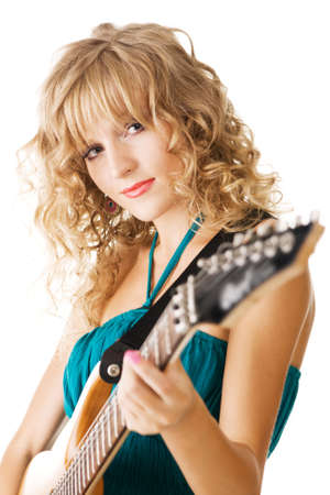Pretty young woman playing an electric guitar photo
