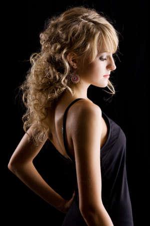Young beautiful woman low-key portrait photo