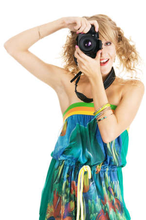 Cheerful young womanshooting with a digital photo camera photo