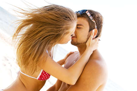 Young beautiful couple kissing at the sea shore Stock Photo - 5482152