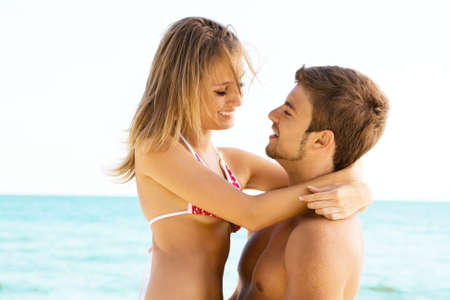 Romantic couple having fun on the seaside Stock Photo - 5482148
