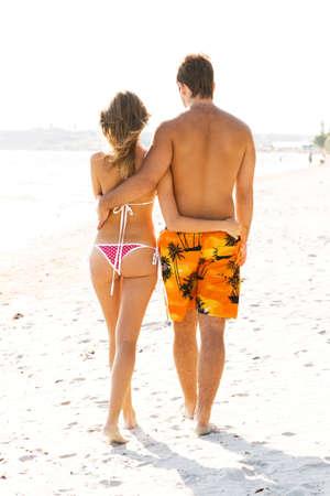 Young beautiful couple walking along the beach Stock Photo - 5474933