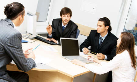 Photo of office workers having a discussion photo