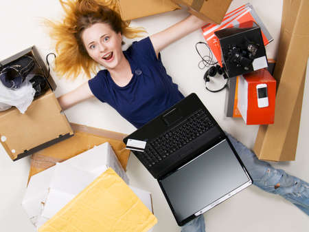 Young girl surrounded with her delivered online orders Stock Photo - 5488458