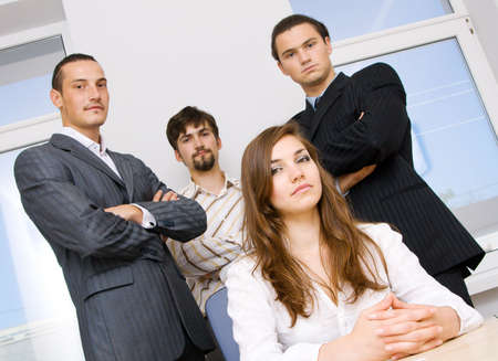 Sucessful business team, focus on woman photo