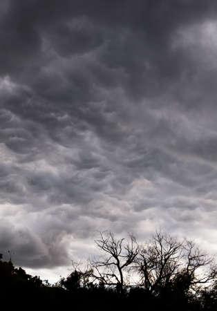 gleams: Dark stormy sky with silver gleams of sunlight