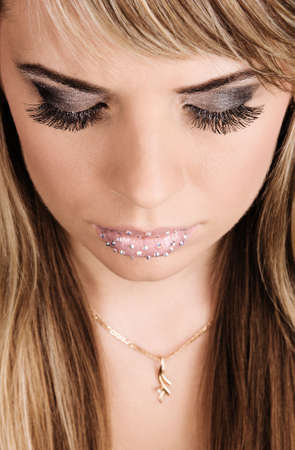 Young beautiful lady with creative makeup photo