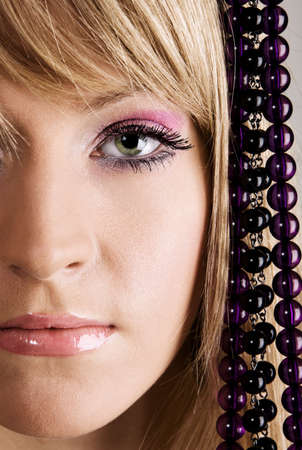Beautiful young woman with beads studio photo photo