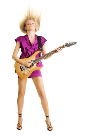 Attractive lady expressively playing an electric guitar photo