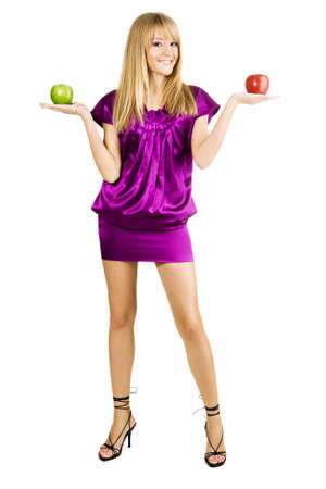 Young beautiful woman holding two apples, isolated on white background photo