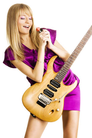Young lady playing an electric guitar, isolated on white background photo