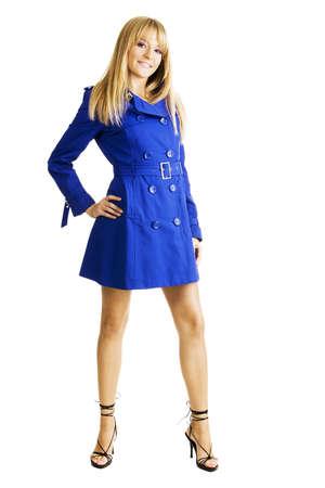 Beautiful young woman in blue autumn coat photo