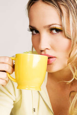 Beautiful woman drinking tea face portrait photo