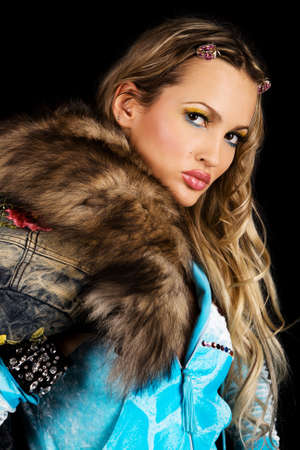 blue grey coat: Gorgeous young woman with fur clothing, black background