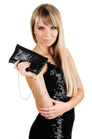 Charming young woman in black evening gown with fancy-bag photo