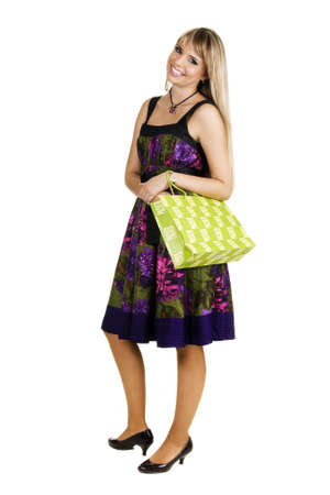 Cheerful young woman with shopping bag, white background photo
