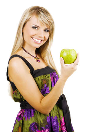 Cheerful young woman holding a fresh freen apple, white background photo