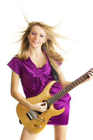 Hot girl playing an electric guitar, isolated on white background photo